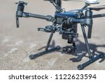 drone flying and working for... | Shutterstock . vector #1122623594