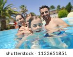 portrait of happy family at the ... | Shutterstock . vector #1122651851