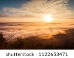 sunrise and the mist in winter...   Shutterstock . vector #1122653471