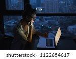 overtime concept. woman is... | Shutterstock . vector #1122654617