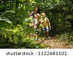 mother and her little sons ... | Shutterstock . vector #1122681101