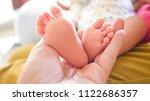 baby's foot in the hands of...   Shutterstock . vector #1122686357