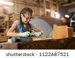 girl building birdhouse in... | Shutterstock . vector #1122687521