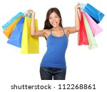 Shopping woman holding shopping bags above her head smiling happy during sale shopping spree. Beautiful young female shopper isolated on white background. - stock photo