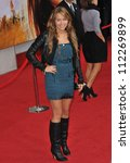 "LOS ANGELES, CA - APRIL 2, 2009: Miley Cyrus at the world premiere of their new movie ""Hannah Montana The Movie"" at the El Capitan Theatre, Hollywood. - stock photo"