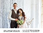 bride and groom hug and pose... | Shutterstock . vector #1122701009