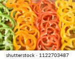 rows of thin sliced yellow  red ... | Shutterstock . vector #1122703487