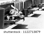 poor homeless man or refugee... | Shutterstock . vector #1122713879