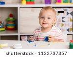 portrait of a little girl who...   Shutterstock . vector #1122737357