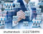 businessman draws franchise... | Shutterstock . vector #1122738494