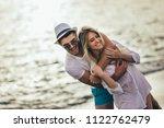 romantic couple having fun on... | Shutterstock . vector #1122762479