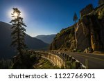 sunstar effect in a pine tree... | Shutterstock . vector #1122766901