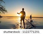 men  friends sail on a sup... | Shutterstock . vector #1122771251