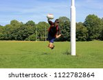 teenage boy playing rugby on a...   Shutterstock . vector #1122782864
