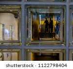 view through a glass wall of... | Shutterstock . vector #1122798404