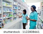 two african american pharmacist ... | Shutterstock . vector #1122808661