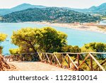 chia beach near blue waters of... | Shutterstock . vector #1122810014