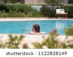 little girl swimming in a pool | Shutterstock . vector #1122828149