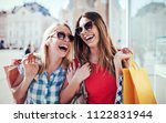 women in shopping. two happy... | Shutterstock . vector #1122831944