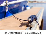 A Blue Yacht Moored With A Lin...