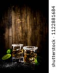 two tequila shot glasses on... | Shutterstock . vector #1122881684