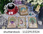 tarot cards with cup of tea ... | Shutterstock . vector #1122915524