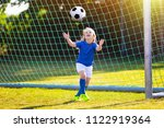 kids play football on outdoor...   Shutterstock . vector #1122919364