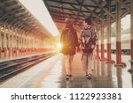happy young couple on railway... | Shutterstock . vector #1122923381