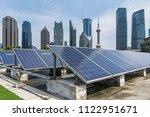 solar and modern city skyline  | Shutterstock . vector #1122951671