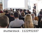 speaker giving a talk in... | Shutterstock . vector #1122952337