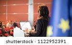 female speaker giving a talk on ... | Shutterstock . vector #1122952391