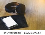 phone with headphones on wooden ... | Shutterstock . vector #1122969164