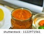 homemade sauce adjika with...   Shutterstock . vector #1122971561
