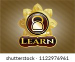 golden emblem or badge with... | Shutterstock .eps vector #1122976961