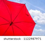 red sunshade umbrella on the sky | Shutterstock . vector #1122987971