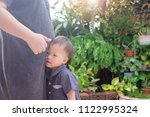 cute little asian 2 years old... | Shutterstock . vector #1122995324