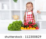 Healthy nutrition base, the vegetables approved by happy little girl - stock photo