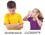 Mocking and teasing among children - girl taunting upset boy, isolated - stock photo