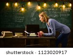 woman typing on a typewriter in ... | Shutterstock . vector #1123020917