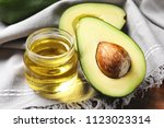 jar with oil and ripe fresh... | Shutterstock . vector #1123023314