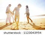 family having fun writing... | Shutterstock . vector #1123043954