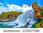 mountain waterfall closeup in... | Shutterstock . vector #1123077584