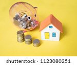 house model and coin money on... | Shutterstock . vector #1123080251