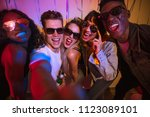 friends posing for a selfie... | Shutterstock . vector #1123089101