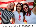 Three Female Friends Smiling...