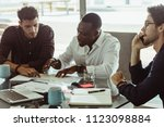 businessmen discussing work... | Shutterstock . vector #1123098884