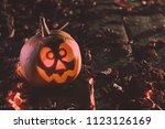 halloween pumpkins at wood...   Shutterstock . vector #1123126169