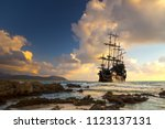 Pirate ship at the open sea at...