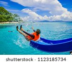 asian man playing the slider on ... | Shutterstock . vector #1123185734