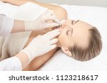 sugar hair removal from woman... | Shutterstock . vector #1123218617